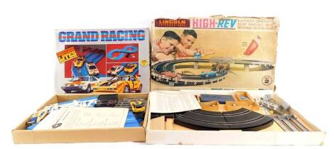 A Lincoln International High-Rev battery operated slot racing set, with revving motor roar, set no 2, together with a Hong Kong battery operated Grand Racing set, no 7642/PLBW, both boxed. (2)