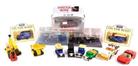 Die cast and other vehicles, including a Lesney JCB 808., Corgi Ferrari 308GTS., two Tetley On The Road Vintage Trucks., Corgi Inspector Morse Jaguar 2.4, 01803., and two models of the Batmobile, some boxed. (a quantity)