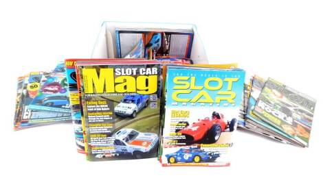 Scalextric Club Magazines, and further ephemera, in a Scalextric box.
