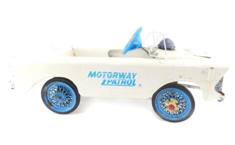 A Tri-ang Motorway Patrol pedal car, 85cm wide.