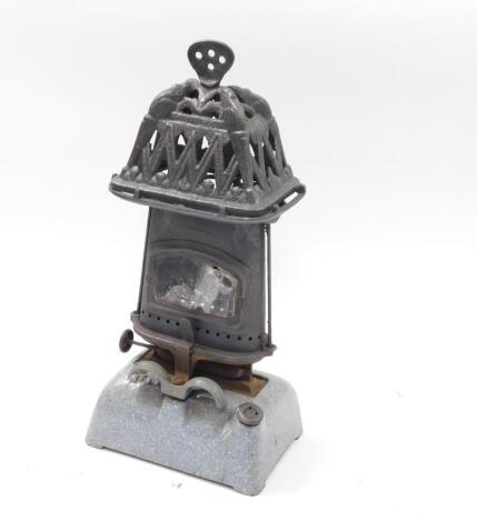 An early 20thC cast iron and turquoise enamel Beatrice stove, 42cm high, 19cm wide, 13.5cm deep. Auctioneer Note: We have specific vendor instructions to sell WITHOUT RESERVE.