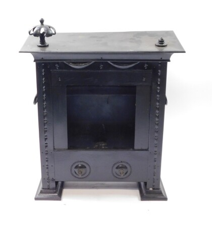 A Continental early 20thC black painted tin electric Dowsing type heater, of neo classical form, innards strip out, 62cm high, 54cm wide, 20.5cm deep. Auctioneer Note: We have specific vendor instructions to sell WITHOUT RESERVE.