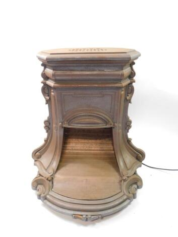 A Continental late 19thC cast iron and copper heater, of shaped scrolling form, converted to electricity, 68cm high, 48cm wide, 53cm deep. Auctioneer Note: We have specific vendor instructions to sell WITHOUT RESERVE.