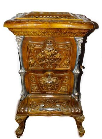 A French late 19thC Goudin cast iron polished metal and enamel stove, Model No 287., of serpentine form with a hinged cover and three floral moulded doors and drawers, raised on cabriole legs, 85cm high, 50cm wide, 38cm deep. Auctioneer Note: We have spec