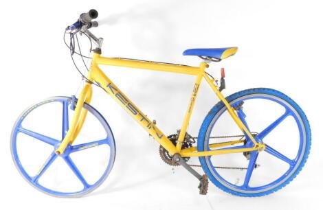 "A British Eagle Kestin yellow and blue mountain bike, with 26"" aluminium wheels, and 21 gears, Vuelta saddle."