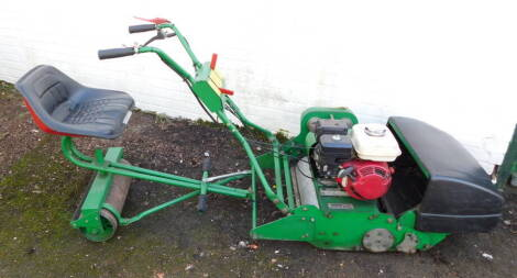 A Dennis Simplex ride-on lawnmower, model no 0510, c2007, serial no 0 510 108, manual and other paperwork.