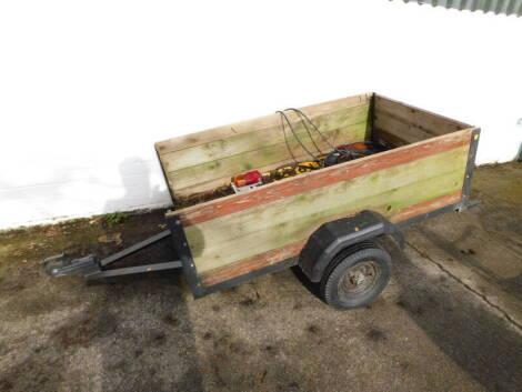 A wooden and metal framed two wheel trailer, 152cm wide, 90.5cm deep.