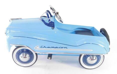 A vintage 'Champion' painted steel pedal car, 100cm long.
