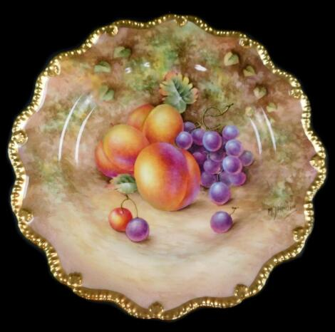 A Royal Worcester porcelain cabinet plate, signed M Johnson, painted with peaches and black grapes, 23cm diameter.