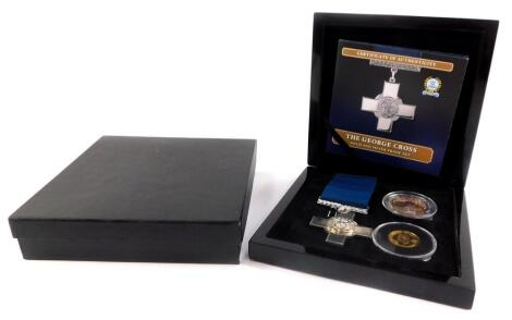 A Bradford Exchange George Cross gold and silver proof set, comprising a replica George Cross medal., 9ct gold Elizabeth II double crown, and a silver crown, boxed with certificate.