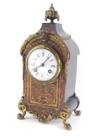 A French late 19thC Boulle mantel clock, circular enamel dial bearing Roman and Arabic numerals, eight day movement with coil strike, stamped Fabrique de Paris., the case cast with a bowl of fruit finial, mask and scrolling leaves, raised on cabriole legs