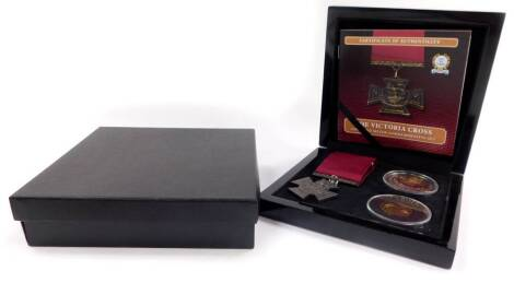 The Bradford Exchange Victoria Cross Silver Commemorative Set, comprising a replica VC medal., 9ct gold Elizabeth II double crown., and a silver crown, boxed with certificate.