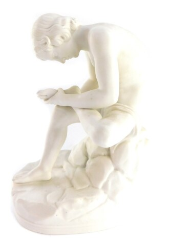 A late 19thC parian porcelain figure of The Spinario, After The Antique, raised on a naturalistic oval base, stamped BC187, 28cm high.