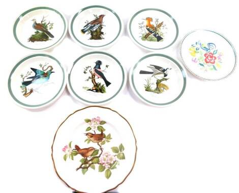 Four Hornsea pottery storage jars decorated in the Fleur pattern, comprising Sugar., Coffee., Tea and unnamed., six Portmeirion plates decorated in the Birds of Britain pattern, Poole pottery plate traditionally painted with a bird and flowers, and a Spo