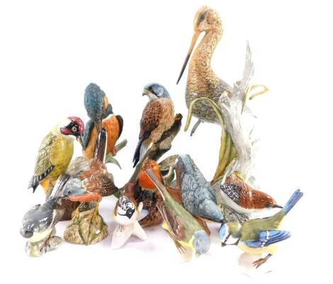 A group of Mack porcelain figures of birds, comprising green woodpecker., nuthatch., wren., black tailed godwit., kestrel and a Dartford warbler., together with Goebel birds, comprising yellow wagtail., blue titmouse., crested tit., robin and kingfisher,
