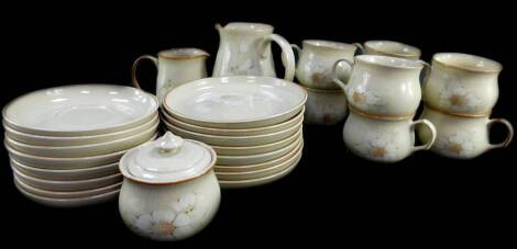 A Denby pottery part tea service decorated in the Daybreak pattern, comprising milk and cream jugs, sucrier, eight cups, saucers and tea plates.