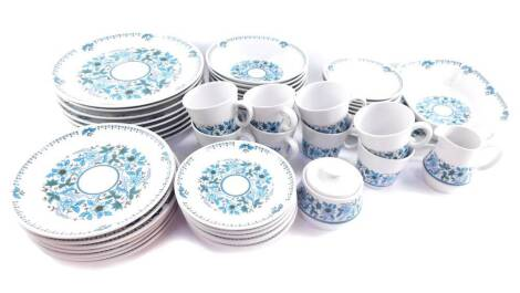 A Noritake Progression china part dinner and tea service decorated in the Blue Moon pattern, comprising meat platter, vegetable dish, eight dinner, seven dessert and eight side plates, eight soup bowls, cream jug, sucrier, eight cups and saucers.