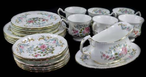 A Royal Standard porcelain part dinner and tea service decorated in the Mandarin pattern, comprising oval meat platter, pair of vegetable tureens and covers, sauce boat on stand, five dinner plates and side plates, six tea cups, saucers and plates.