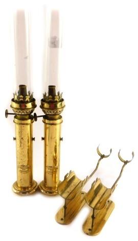 A pair of Danish brass maritime Kerosene lamps, by G V Harnisch EFTF of Kjobenhavn., Nos 61958 and 61132., with brackets, 37cm high.
