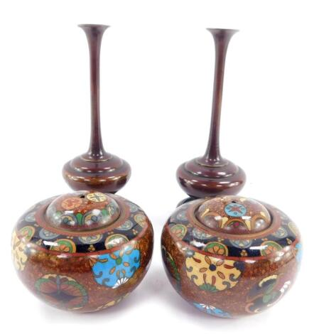 A pair of Qing Dynasty cloisonne pots and covers, of cylindrical form, decorated with birds, Buddhistic emblems and floral motifs, 9cm diameter., together with a pair of bronze vases, of baluster form, on wooden stands, 16cm high. (4)