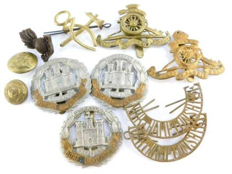 Military cap badges and buttons, including the Northamptonshire Regiment, and Royal Artillery. (a quantity)