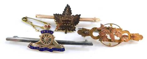 A 9ct gold maple leaf bar brooch, engraved for Canada, a Victorian 9ct gold brooch cast with a bird and flowers, 4.2g., and a silver and enamel Royal Artillery bar brooch. (3)