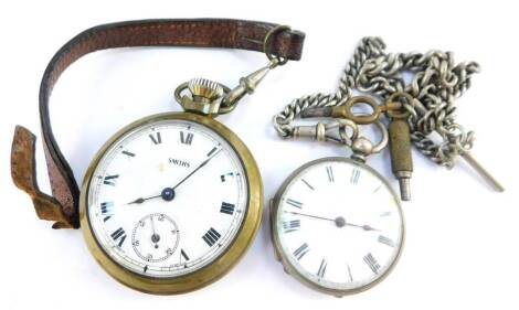 A late 19thC pocket watch, open faced, key wind, enamel dial bearing Roman numerals, the case stamped fine silver, with engine turned decoration, shield and garter reserve, with keys, on a plated curb link Albert chain, together with a Smith's brass cased