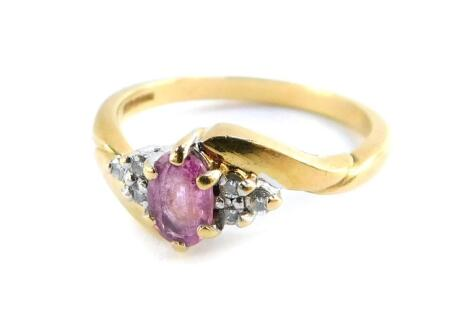 An 18ct gold pink sapphire and diamond set ring, in a crossover design, size O., 3.4g.