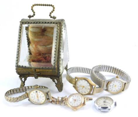 An Oris lady's gold plated wristwatch, Ingersoll Legend wristwatch, three further dress wristwatches, and a Victorian glass panelled pocket watch holder, metal framed. (6)