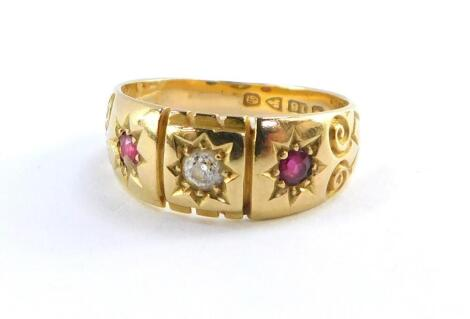 An Edwardian lady's 18ct gold diamond and ruby three stone ring, size M, 4.2g.