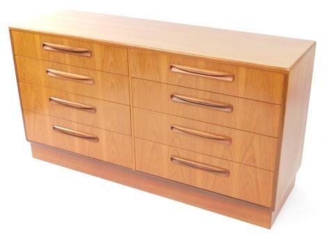 A G plan teak chest of eight drawers, raised on a plinth base, 75.5cm high, 141.5cm wide, 44.5cm deep.