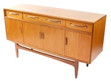 A G plan teak sideboard, with one long flanked by two short drawers, over four cupboard doors, raised on tapering square legs, 84cm high, 152cm wide, 45.5cm deep.