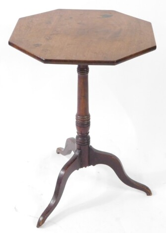 A late Georgian mahogany tilt top occasional table, the octagonal top raised on a ring turned column over three cabriole legs, 67cm high, 46.5cm diameter.