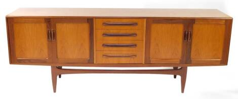 A G plan teak sideboard, with four central drawers flanked by two pairs of cupboard doors, raised on tapering square central legs, 80cm high, 213cm wide, 45.5cm deep.