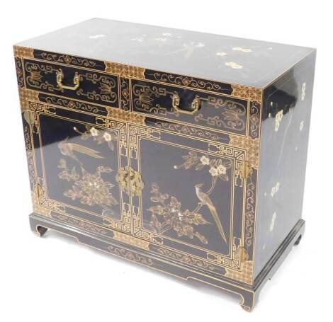 A TCC Chinese 20thC black lacquered chest, painted with birds and blossom, having two frieze drawers above a pair of cupboard doors opening to reveal a single shelf, raised on ogee bracket feet, 77cm high, 91cm wide, 45.5cm deep.