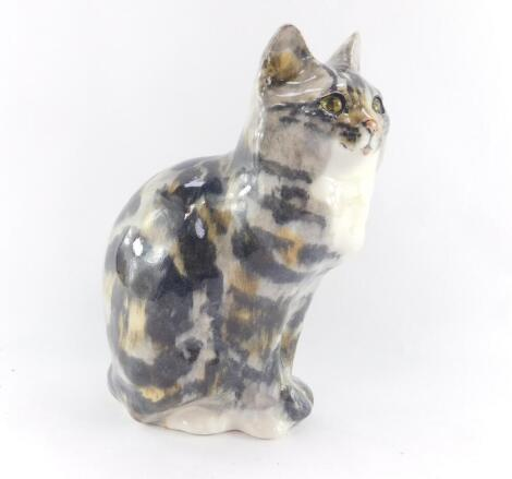 A Winstanley pottery tabby cat, modelled in seated pose with glass eyes, painted mark, 31cm high.