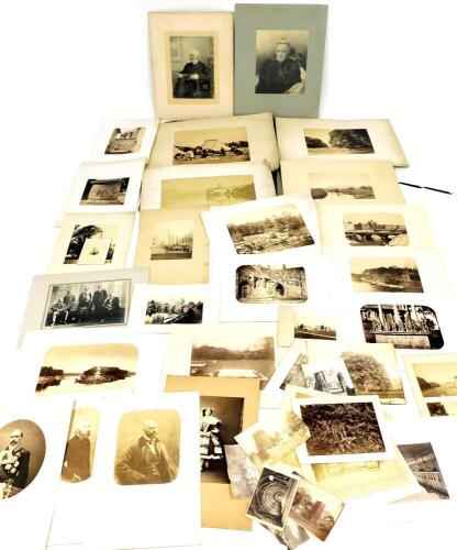 A collection of 19thC and later photographic monochrome prints, including Continental topography including Paris, Kings Sutton (Northants), and portraits, etc., in portfolio.