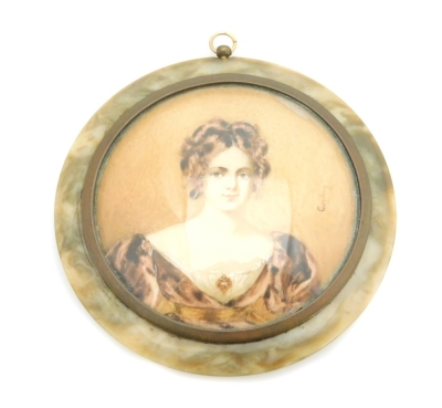 An early 19thC portrait miniature of a lady, with brunette hair in brown dress, on a brown coloured border, painted on panel and signed Corday, 6.5cm diameter, with a brass frame, in a tortoiseshell case with applied floral decoration, 8cm wide.