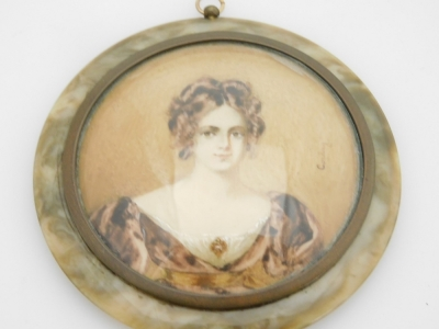 An early 19thC portrait miniature of a lady, with brunette hair in brown dress, on a brown coloured border, painted on panel and signed Corday, 6.5cm diameter, with a brass frame, in a tortoiseshell case with applied floral decoration, 8cm wide. - 2