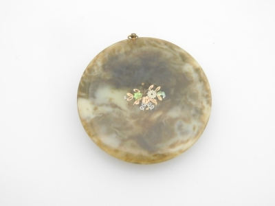 An early 19thC portrait miniature of a lady, with brunette hair in brown dress, on a brown coloured border, painted on panel and signed Corday, 6.5cm diameter, with a brass frame, in a tortoiseshell case with applied floral decoration, 8cm wide. - 4