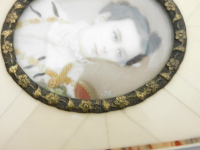 A late 19thC portrait miniature of a military gentleman, depicting a man in dress uniform possibly Ludwig II of Bavaria, signed Silas?, 3.5cm x 4.5cm, in a metal oval frame with applied floral decoration and ivory panelled border, with newspaper article b - 4