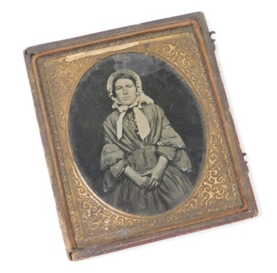A late 19thC daguerreotype photograph miniature, depicting a lady, in a gold coloured frame, in a brown leather case, 8cm x 9xm. (AF)