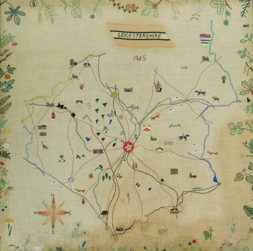 A late 20thC embroidered map of Leicestershire dated 1965, depicting various lions, animals and flowers, in a oak frame, 62.5cm x 62cm.
