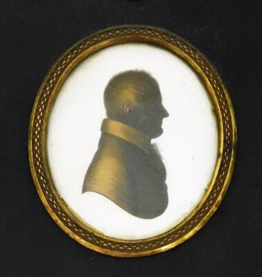 A 19thC silhouette lady, facing sinister, of oval form, quarter profile, finely dressed, hand written to the back Jane Sarah Wightwick 1821, on plaster and ebonised frame, 8cm x 7cm, a similar portrait of a gentleman facing dexter 1821, and another. (3) - 2