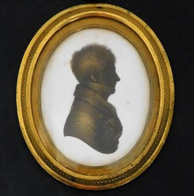 A 19thC silhouette lady, facing sinister, of oval form, quarter profile, finely dressed, hand written to the back Jane Sarah Wightwick 1821, on plaster and ebonised frame, 8cm x 7cm, a similar portrait of a gentleman facing dexter 1821, and another. (3) - 4