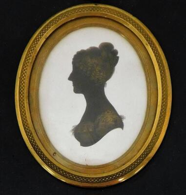 A 19thC silhouette lady, facing sinister, of oval form, quarter profile, finely dressed, hand written to the back Jane Sarah Wightwick 1821, on plaster and ebonised frame, 8cm x 7cm, a similar portrait of a gentleman facing dexter 1821, and another. (3) - 6