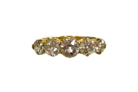 A Victorian diamond five stone dress ring, set with five round brilliant cut diamonds, the central stone 6.2mm x 3.2mm, approx 0.79cts, flanked by two smaller stones, each 5.2mm x 2.4mm, approx 0.59cts each, with a further two smaller stones each measurin