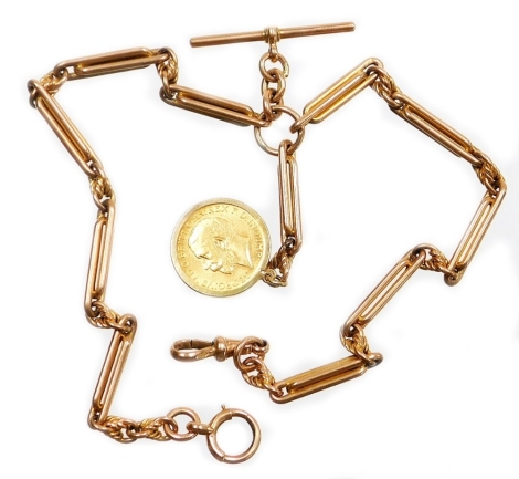 A 9ct gold watch chain, with clip T bar and applied George V full gold sovereign dated 1912, in a 9ct gold mount surround, the rose gold watch chain with joined bar links and twist clasp decoration, stamped 9ct, 39cm long, 61.9g all in.