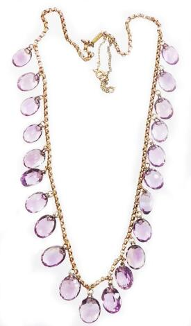 An Edwardian design amethyst graduated beaded necklace, set with twenty two oval cut amethysts, on a curb link chain, yellow metal, unmarked, with replacement and plated clasp, 48cm long overall, the largest bead 15mm, 37.6g all in.
