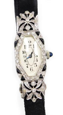 An early 20thC diamond set ladies cocktail watch, with a hexagonal shaped dial, in a white enamel finish, with cabochon sapphire dial, in a white metal casing stamped platinum, on a black ribbon band, the watch head 2.5cm long, in a Pearce & Sons Ltd of L